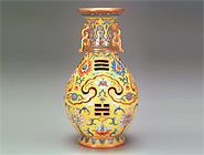 Revolving Vase in Yellow Glaze Famille Rose with Auspicious Motifs