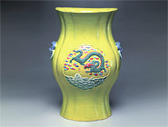 Floral Vase with Fish and Dragons on a Green Background